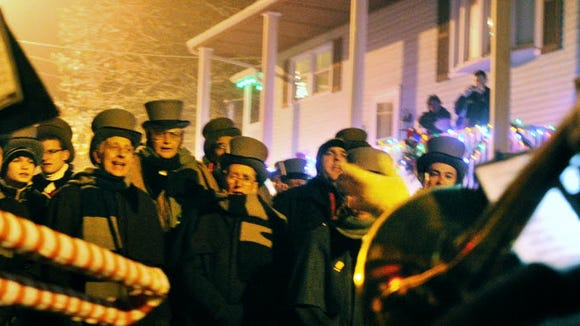 The Glen Rock Carolers pause on the streets of that southern York County borough in 2012.