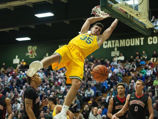 Vermont's Payton Henson (35) dunks the ball during the men's basketball game between the Northeastern Huskies and the Vermont Catamounts at Patrick Gym on Saturday afternoon.