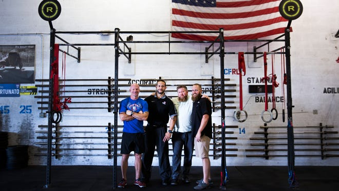 Anthony DiSarro, from left, Rafael Hernandez, Justin Lang and Jesse Peterson stand Monday, Nov. 6, 2017, at Crossfit Redline in East Naples. They took cases of luggage full of medical supplies and toiletries to help people affected by Hurricane Maria.
