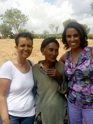 Wegayhu Ketema, right, stands with a resident on a plot of land where Siloam Ethiopia Ministries plans to build a health clinic. She is joined by Almaz Mola, left, a member of Ethiopian Evangelical Church where Ketema's husband is pastor. Mola donated the land in support of Siloam Ethiopia Ministries.