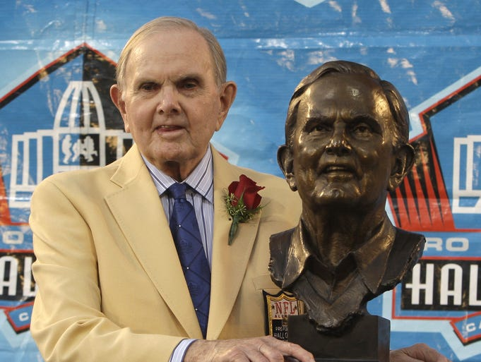 Founder and owner of the Buffalo Bills, Ralph Wilson Jr., stands with his bronze bust during the Pro Football Hall of Fame induction ceremony at the Pro Football Hall of Fame Aug. 8, 2009, in Canton, Ohio.