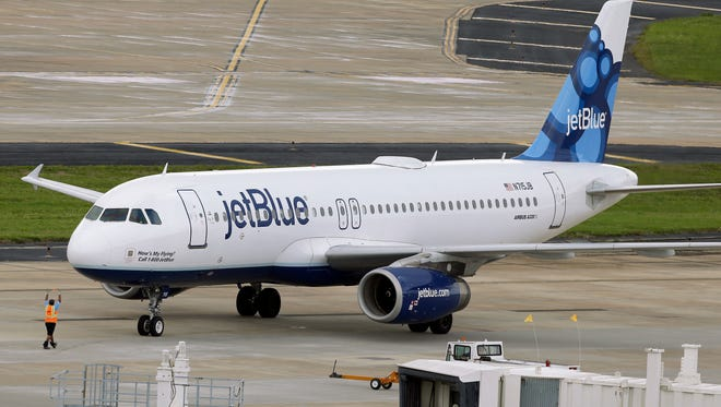 A JetBlue Airways Airbus A320-232 pushes back from the gate at Tampa International Airport on May 15, 2014.