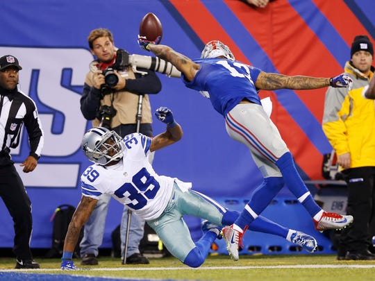 Odell Beckham Jr. making the now-famous one-handed catch for a touchdown against the Cowboys in 2014.
