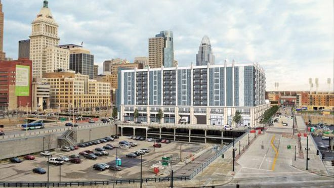 An apartment building, above right, is planned for The Banks, but a deal  to allow it, along with upgrades to Paul Brown Stadium, above left, would also open the possibility of a new building for GE.  above right; Provided; Above left: Enquirer file Image altered to remove annotations added by graphic artist.