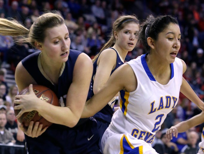 Appleton North's Sydney Levy rips a rebound from the