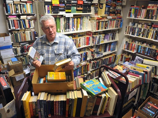 Alan Martin, president of the Friends of the Wichita Falls Public Library, sorts through books in this file photograph.