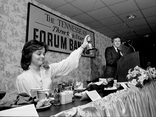 Sandra Roberts, left, chief librarian for The Tennessean, clangs the bell used at the newspaper's Three-Star Forum Banquet on June 2, 1978, to show that time is up as Publisher John Seigenthaler gets ready to turn the forum over to the six gubernatorial hopefuls, who had five minutes to say their piece.