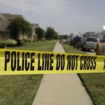 Crime scene tape marks the area law enforcement investigators are working outside the house of a fatal shooting Aug. 8, 2013, in DeSoto, Texas. Investigators arrested Erbie Bowser.
