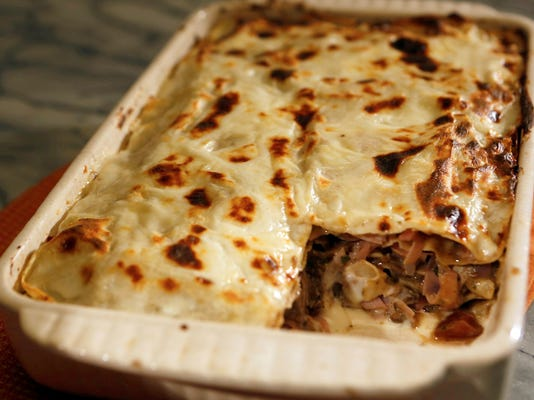 There's nothing like lasagna from scratch to while away a lazy Sunday afternoon, and a mushroom and ham lasagna can be a habit-forming choice.  (Anne Cusack/Los Angeles Times/MCT)