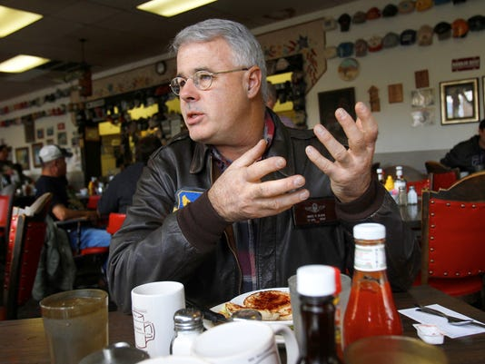 Retired Lt. Col. Bruce Black Jr. talks about his experience as a military drone pilot on Monday at Ann's Restaurant in Farmington.