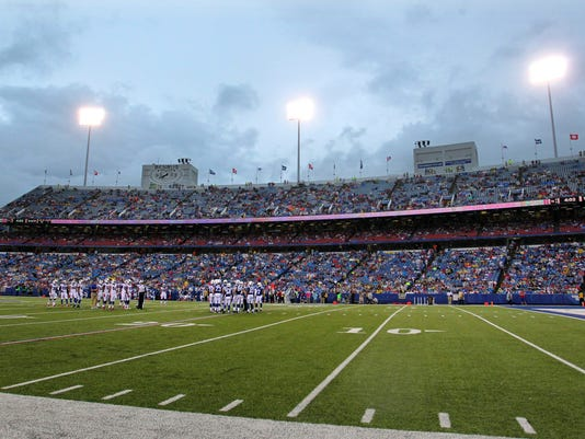 The Buffalo Bills and the Indianapolis Colts huddle during the first half of a preseason NFL football game at Ralph Wilson Stadium Saturday, Aug. 13, 2016, in Orchard Park, N.Y. The Bills announced on their Twitter account on Saturday they reached an agreement to sell the naming rights of their home stadium to Buffalo-based New Era Cap Company. (AP Photo/Bill Wippert)