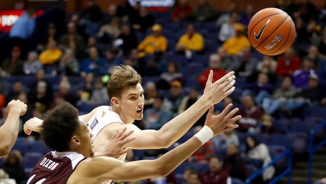 Northern Iowa's Bennett Koch, right, and Missouri State's Jarred Dixon reach for the ball during the first half of an NCAA college basketball game in the quarterfinals of the Missouri Valley Conference men's tournament Friday, March 3, 2017, in St. Louis. (AP Photo/Jeff Roberson)