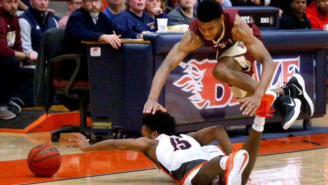 Riverdale's Elijah Cobb dives over Blackman's James Polite (15) for a loose ball during Tuesday's game at The Inferno.