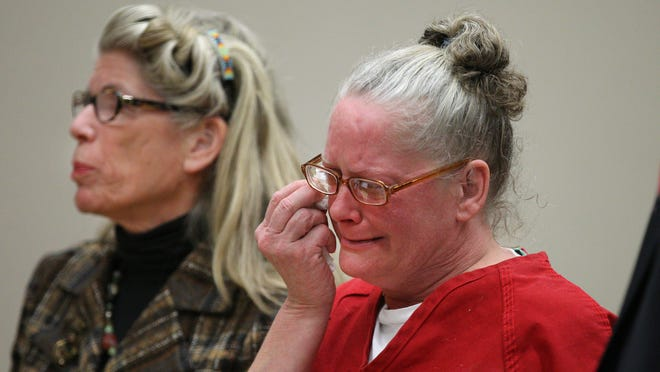 An emotional Rene Bailey listens as her attorney, Adele Bernhard, argues in front of Judge James Piampiano.