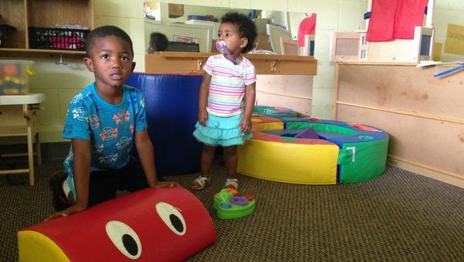 Za'Nyrian Richard (left), 4, and Brooklyn Taylor, 1, play in a classroom at the Derboune Head Start Center in Cheneyville on Monday.
