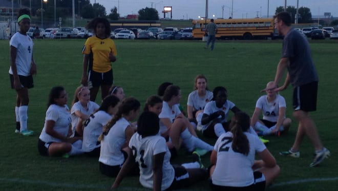 Peabody's soccer players listen to coach Joseph Wuchter after a win Tuesday over South Side.