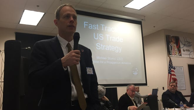 Michael Stumo, CEO of the Washington-based advocacy group Coalition for a Prosperous America, talks during a panel discussion about manufacturing, jobs and trade Wednesday.
