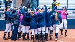 The Michigan softball team celebrates during an 8-0 win over Western Michigan on May 2, 2017 in Ann Arbor.