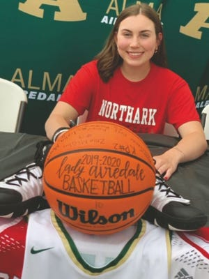 Alma standout Zoie McGhee signs a national letter of intent to continue her basketball and academic career at Northark during a ceremony on May 21.