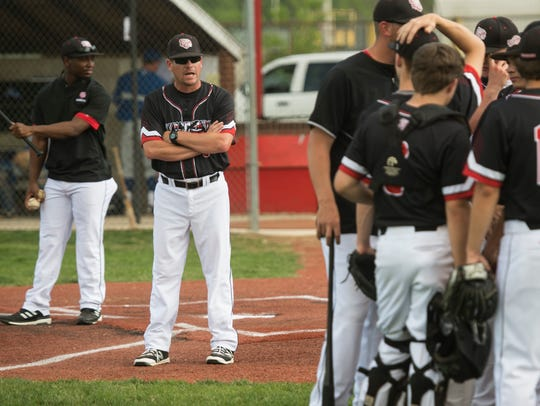 Harrison head coach Josh Heldt yells a few last words of encouragement before his team takes the field at Harrison's baseball field on Thursday, May 10, 2018.