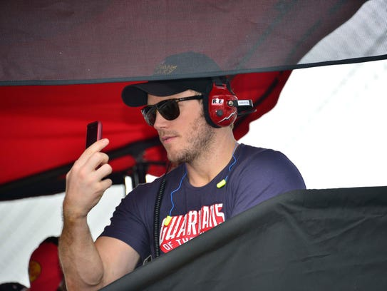 Pace car driver actor,Chris Pratt sits in the Tony Stewart racing pit box at  the Brickyard 400  NASCAR race July 27, 2014 at The indianapolis Motor Speedway.