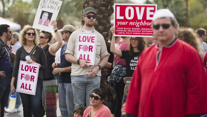 People rally together in solidarity at the Islamic Community Center of Phoenix on Feb. 11, 2017, in Phoenix, Ariz.