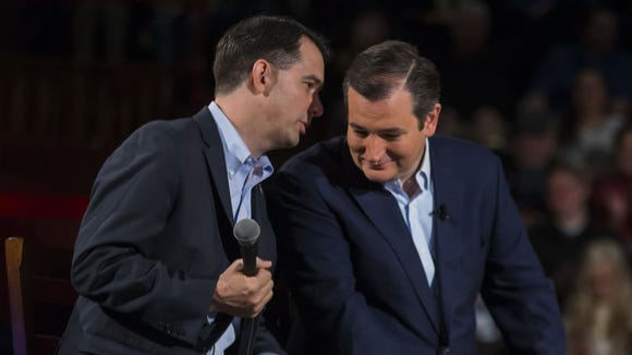 Wisconsin Gov. Scott Walker talks to Sen. Ted Cruz