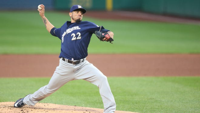 Brewers starting pitcher Matt Garza pitches against the Pirates in the second inning.