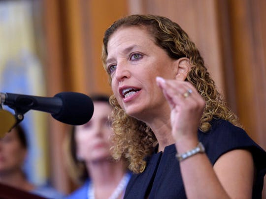 FILE - In this Sept. 7, 2016 file photo, Rep. Debbie Wasserman-Schultz, D-Fla. speaks during a news conference on Capitol Hill in Washington. An FBI investigation and congressional probes into the Trump campaign and contacts with Russia continue to shadow the administration, each new development a focus of White House press briefings and attention on Capitol Hill.