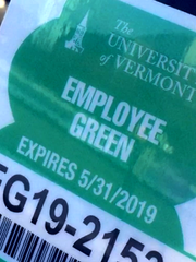 A University of Vermont parking permit is displayed