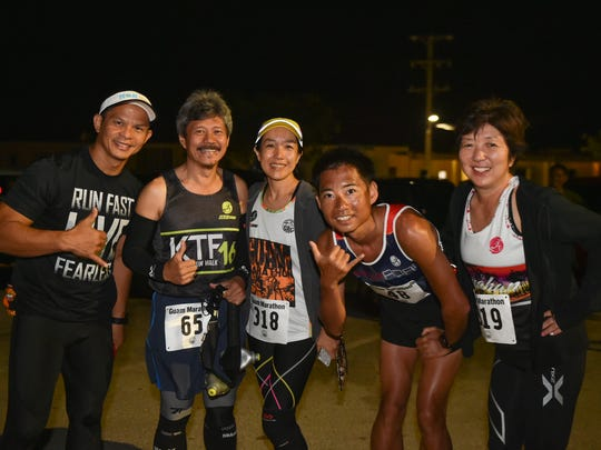 Team Nadeshiko take a picture together before the GRC Guam Marathon at the University of Guam Calvo Field House in Mangilao on March 20, 2015.