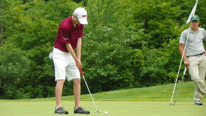 Morristown's Evan Quinn lines up a birdie put attempt in the first sudden death playoff hole. Quinn made the putt to win the NJAC title.