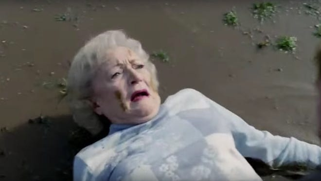 Betty White gets hit in an ad for Snickers.