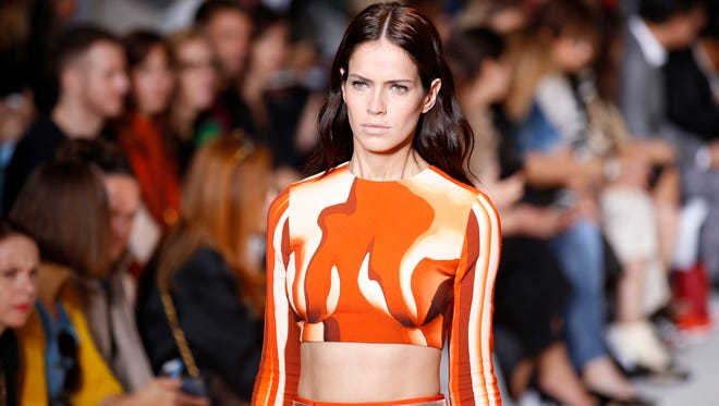 A model wears a creation for Mugler's Spring/Summer 2015 ready-to-wear fashion collection presented in Paris, France, Saturday, Sept. 27, 2014.