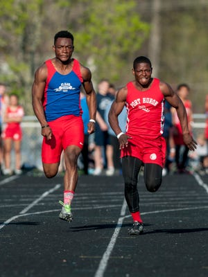 Port Huron senior Jermaine Drake pulls ahead of St. Clair junior Cam Williams in the 100-meter dash during the Marysville Invitational track meet Friday, May 13, 2016 at Marysville High School.