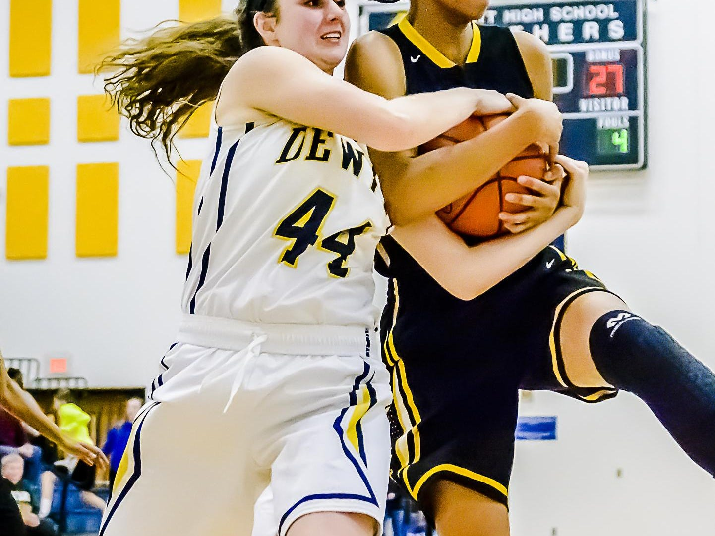 Alisia Smith ,right, of Waverly grabs the ball from Lilly George of DeWitt as George attempted a shot during their game Friday February 12, 2016 in DeWitt. KEVIN W. FOWLER PHOTO