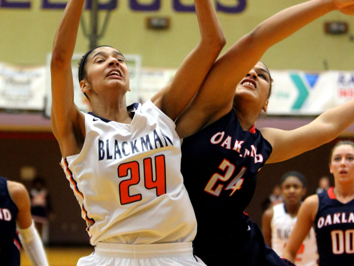 Blackman's Jazz Bond and Oakland's Aaliyah Patterson firght for a rebound in the Region 4-AAA final game held at Smyrna on Friday Feb. 27, 2015.
