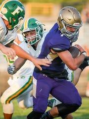 Louisville Male High School Garrett Dennis (7) avoids