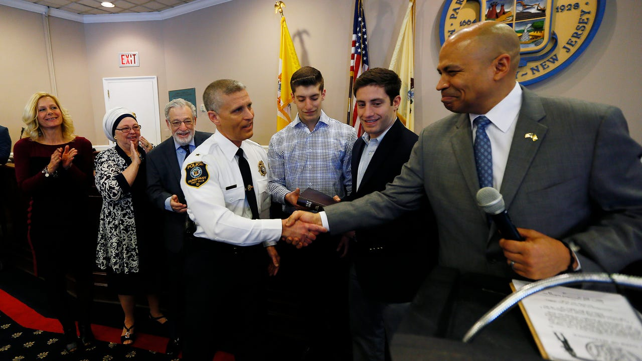 Parsippany Mayor Michael Soriano presided over swearing in ceremonies for Police Chief Andrew Miller and Capt. Thomas Carney on March 15, 2018. William Westhoven/Dailyrecord.com.