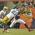 Green Bay Packers cornerback Damarious Randall (23) gains an interception in the fourth quarter against the Denver Broncos during Sunday night's game at Sports Authority Field in Denver, Colo.