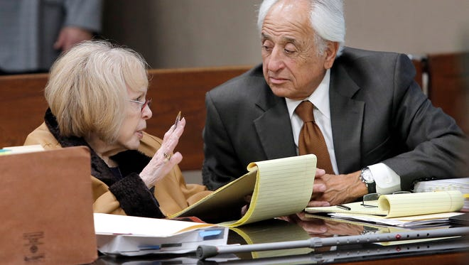 Lisbeth Garrett, 76, talks with her co-counsel Robert Ramos during her murder trial Friday in the 168th District Court with Judge Marcos Lizarraga presiding. Garrett is accused in the 1977 death of her husband, U.S. Army Maj. Chester Garrett. Her son, Roger Garrett, was sentenced to 40 years in prison in a separate trial.