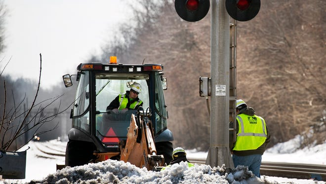Norfolk Southern workers update the wiring of a signal at Locust Street in York Haven in compliance with federal standards for heavier rail transport Wednesday February 25, 2015 for crude oil rail transport story.  Paul Kuehnel - Daily Record/Sunday News