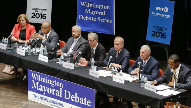 Democrat Wilmington mayoral candidates (from left) Maria Cabrera, Theo Gregory, Norm Griffiths, Kevin Kelley, Bob Marshall, Mike Purzycki and Eugene Young take part in a debate at the baby grand on June 14. The city has seen an influx of Republicans and Independents switch parties to vote in the Democratic primary.