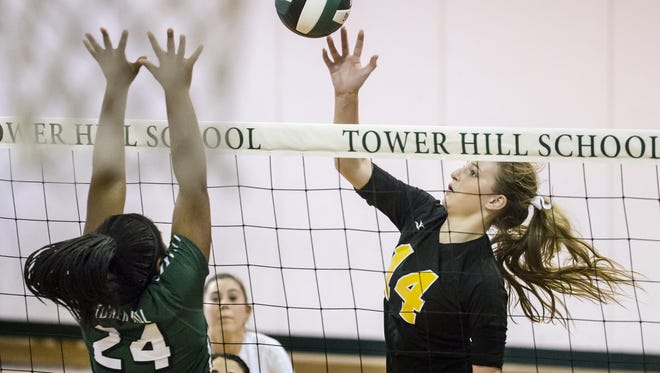 Tatnall's Ashlin DeLucia (right) taps the ball over Tower Hill's Ashleigh Brady on Oct. 18. Both teams will play in the second round of the DIAA Volleyball Tournament on Saturday, as Tatnall meets Smyrna at 7:30 p.m. at Archmere, and Tower Hill takes on Caesar Rodney at 5 p.m. at Wilmington Friends.