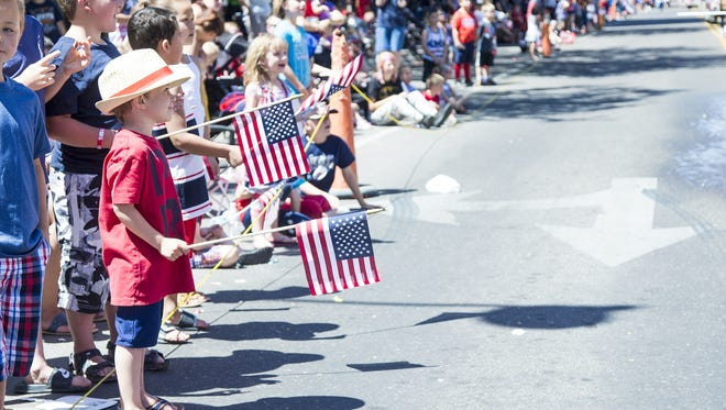 Parade goers form a thick crowd along Central Avenue in Great Falls for last year's Fourth of July parade. The parade was in danger this year as volunteers dwindled.