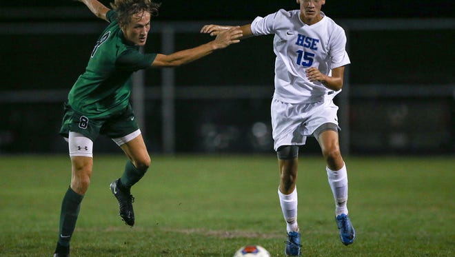 Zionsville Eagles Ben Weidner (8) and Hamilton Southeastern Royals defender Cale Barnes (15) work toward the ball during first half action at Hamilton Southeastern High School, Fishers, Ind., Tuesday, Sept. 19, 2017.