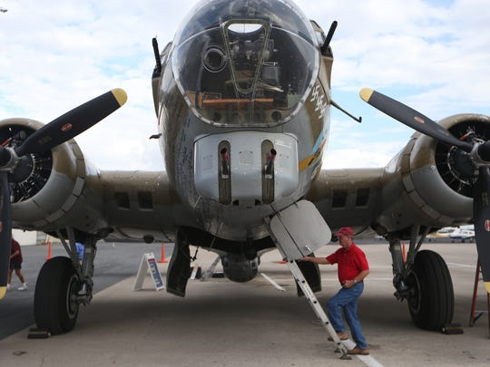 "Visitors inspect the ""Nine O Nine"" Boeing B-17 Flying Fortress on display at the Tallahassee International Airport where the Wings of Freedom Tour is set up Wednesday. The collection of WWII era aircrafts will be on display at the airport until Nov. 4, 2016."