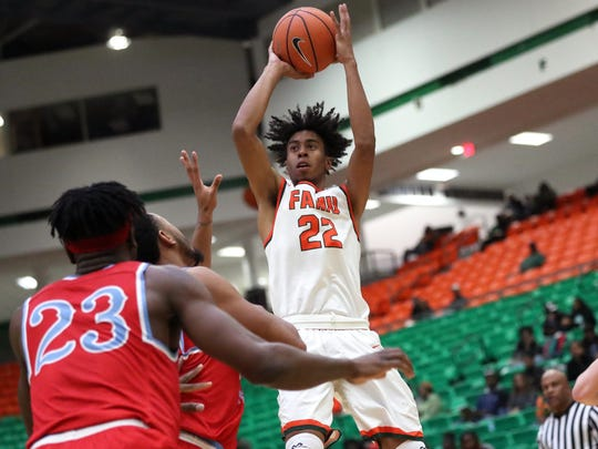 FAMU's Marcus Barham shoots a jumper against Delaware State at the Al Lawson Center on Monday, Jan. 15, 2018.