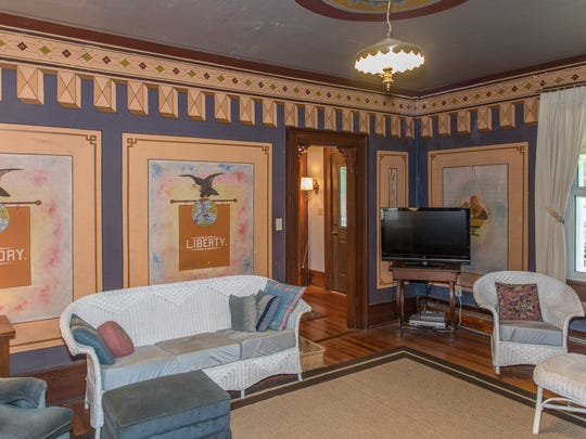 Inside the home at at 4651 Spring Hill Rd. in Mount Solon, which features paintings by G.B. Jones, a local artist and preacher from the early 1900s.