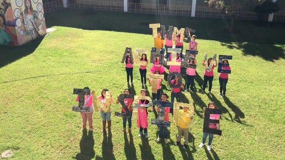 Terrace Hills Middle School students hold up an inspirational message for a photo that will appear in the school yearbook.